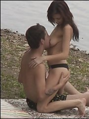 Gal spied while fucking on a river beach